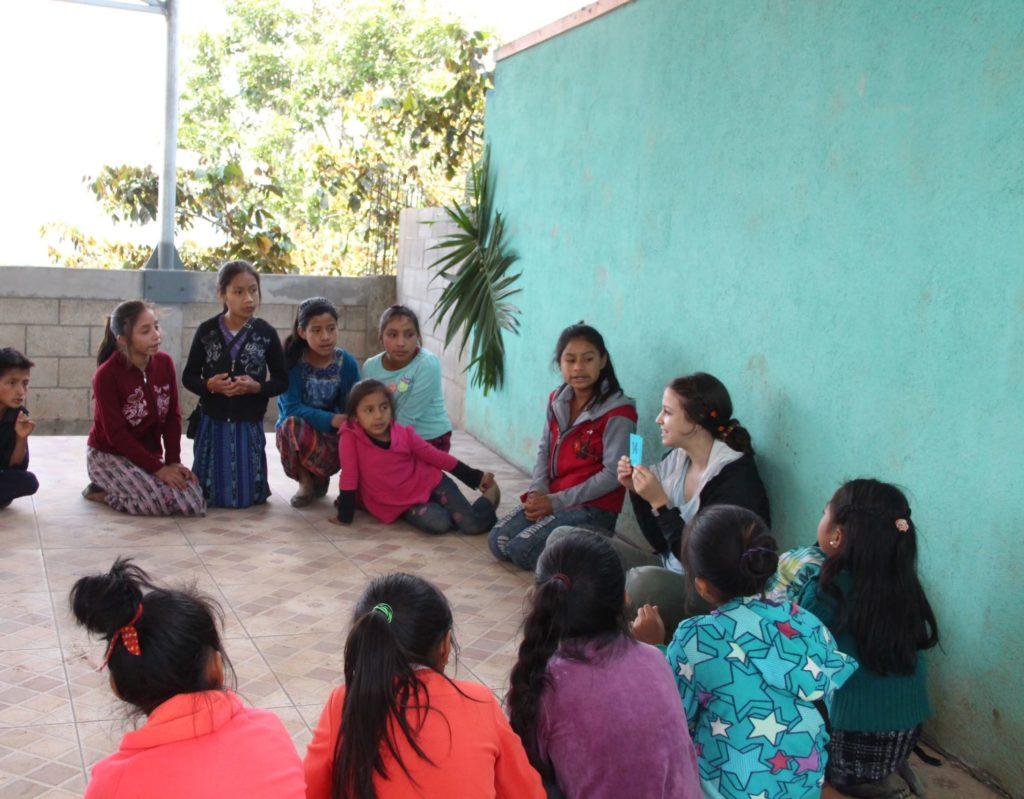Student teaching kids in Guatemala