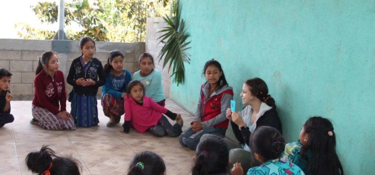 Student teaching kids in Guatemala